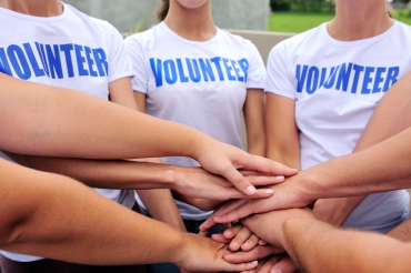 volunteer group hands together showing unity
